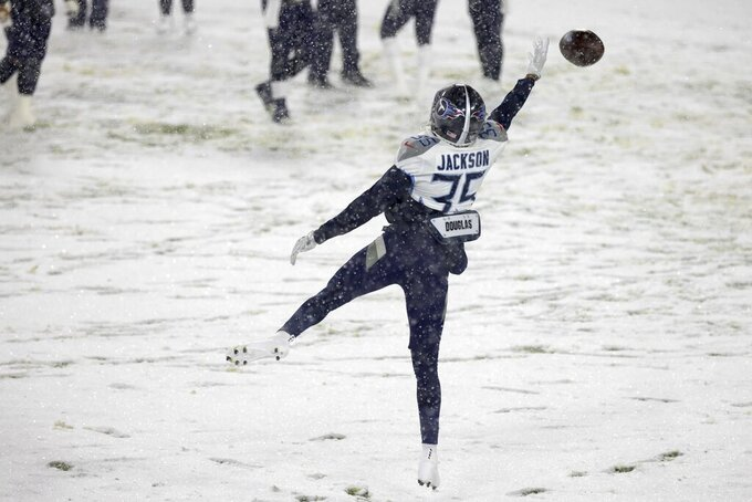 Tennessee Titans' Chris Jackson warms up in the snow before an NFL football game against the Green Bay Packers Sunday, Dec. 27, 2020, in Green Bay, Wis. (AP Photo/Matt Ludtke)