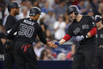Boston Red Sox's Mookie Betts (50) congratulates J.D. Martinez, right, who hit a three-run home run during the sixth inning of the team's baseball game against the San Diego Padres on Friday, Aug. 23, 2019, in San Diego. (AP Photo/Orlando Ramirez)