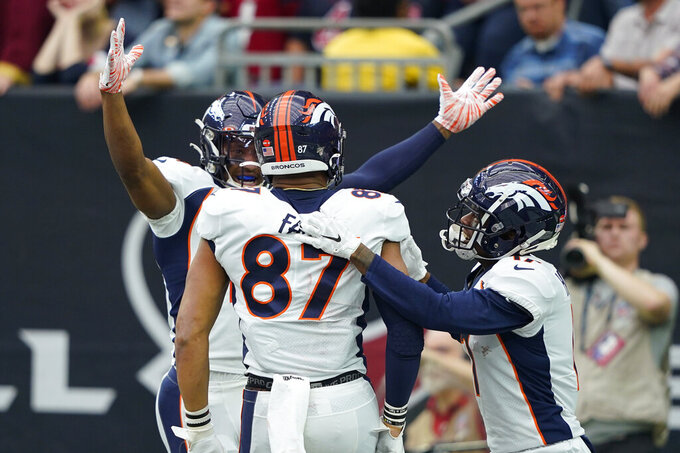 Denver Broncos tight end Noah Fant (87) celebrates his touchdown catch with teammates during the first half of an NFL football game against the Houston Texans Sunday, Dec. 8, 2019, in Houston. (AP Photo/David J. Phillip)