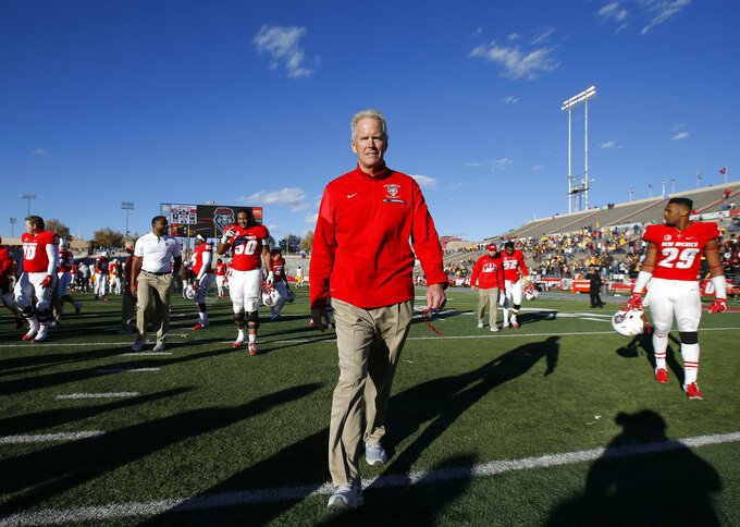 New Mexico coach Bob Davie walks off the field after the NCAA college football game against Wyoming in Albuquerque, N.M., Saturday, Nov. 24, 2018. Wyoming won 31-3. (AP Photo/Andres Leighton)