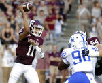 Texas A&M quarterback Kellen Mond (11) throws a pass as Kentucky defensive end T.J. Carter (90) is blocked by offensive lineman Carson Green (54) during the first half of an NCAA college football game Saturday, Oct. 6, 2018, in College Station, Texas. (AP Photo/Michael Wyke)