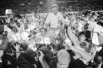 FILE - In this Dec. 18, 1983, file photo, University of Tennessee coach Johnny Majors rides victorious on the shoulders of his team after Tennessee defeated Maryland 30-23 at the Citrus Bowl in Orlando, Fla. Majors, the coach of Pittsburgh's 1976 national championship team and a former coach and star player at Tennessee, has died. He was 85. Majors died Wednesday morning, June 3, 2020, at home in Knoxville, Tenn., according to a statement from his wife, Mary Lynn Majors. (AP Photo/Kirk McKoy, File)