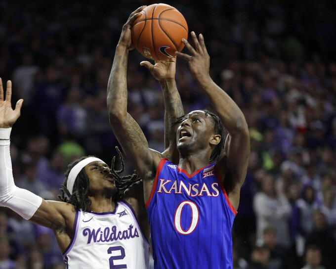 FILE - Kansas guard Marcus Garrett (0) shoots over Kansas State guard Cartier Diarra (2) during the first half of an NCAA college basketball game in Manhattan, Kan., in this Saturday, Feb. 29, 2020, file photo. Garrett averaged 9.2 points last season. (AP Photo/Orlin Wagner, File)