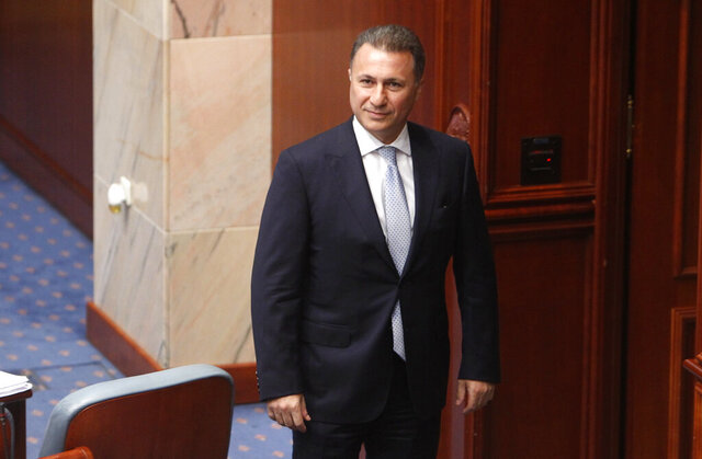 FILE - In this Oct. 19, 2018 file photo, Nikola Gruevski, Macedonia's former prime minister, looks on in parliament in the capital, Skopje. A criminal court in North Macedonia has sentenced former conservative prime minister Nikola Gruevski to 1 1/2 years in prison, and handed suspended sentences to six other party members and supporters for orchestrating violence in 2013, it was reported on Tuesday, Sept. 29, 2020.  (AP Photo/Boris Grdanoski, File)