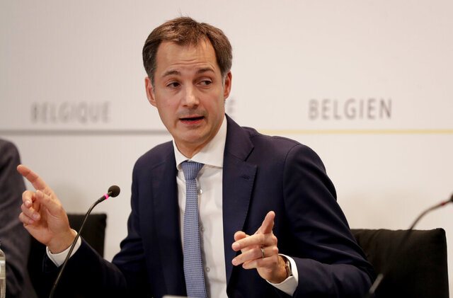 Belgium's Prime Minister Alexander De Croo speaks during a media conference, after a committee to discuss new restrictive measures regarding coronavirus, COVID-19, in Brussels, Friday, Oct. 16, 2020. Faced with a resurgence of coronavirus cases, the Belgian government on Friday announced new restrictions to try to hold the disease in check, including a night-time curfew and the closure of cafes, bars and restaurants for a month. (Stephanie Lecocq, Pool via AP)