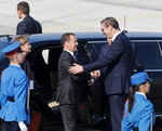 Serbian President Aleksandar Vucic, right, welcomes Russian Prime Minister Dmitry Medvedev prior a military parade at the military airport Batajnica, near Belgrade, Serbia, Saturday, Oct. 19, 2019. Medvedev arrived on a one-day official visit to Serbia during which he attend military parade commemorating the 75th anniversary of the liberation of the Serbian capital from the Nazi German occupation by the Red Army and Communist Yugoslav Partisans. (AP Photo/Darko Vojinovic)