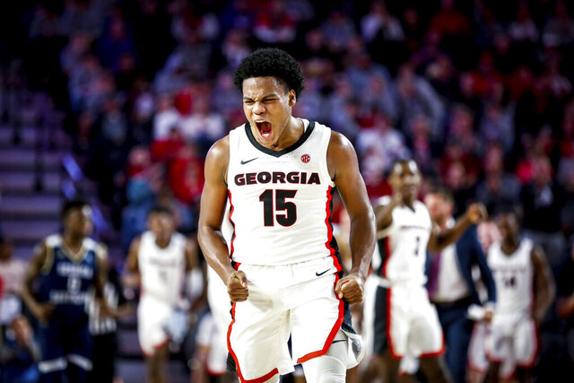 Georgia's Sahvir Wheeler (15) celebrates during the team's NCAA college basketball game against Georgia Southern on Monday, Dec. 23, 2019, in Athens, Ga. (Casey Sykes/Athens Banner-Herald via AP)