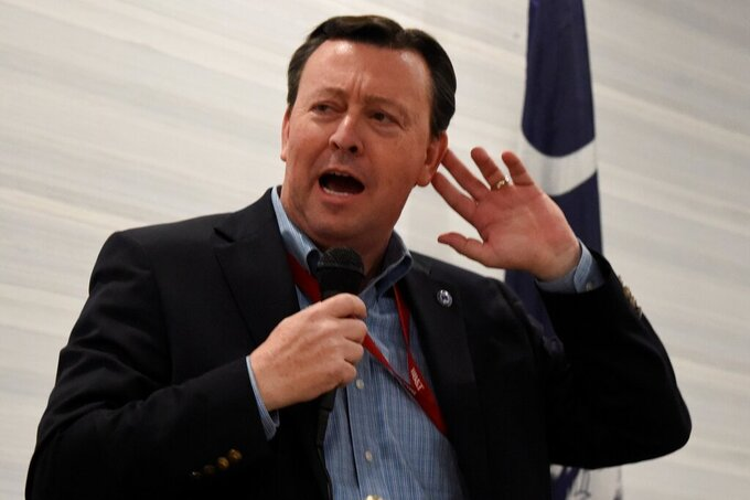South Carolina Republican Party Chairman Drew McKissick gestures as he speaks to the Richland County GOP convention on Friday, April 30, 2021, in , S.C. (AP Photo/Meg Kinnard)