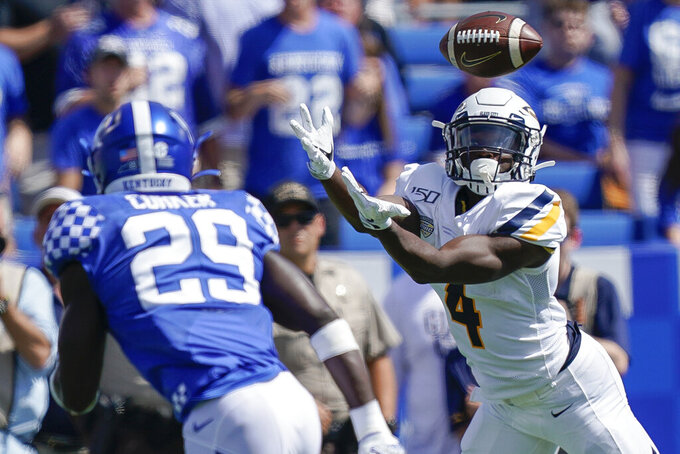 Toledo wide receiver Danzel McKinley-Lewis (4) catches a pass during the first half of the NCAA college football game against Kentucky, Saturday, Aug. 31, 2019, in Lexington, Ky. (AP Photo/Bryan Woolston)