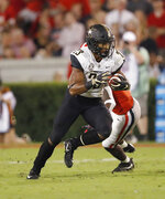 Vanderbilt running back Khari Blasingame (23) runs past a Georgia defender during the first half of an NCAA college football game Saturday, Oct. 6, 2018, in Atlanta. (AP Photo/John Bazemore)