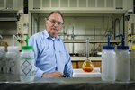 In this Tuesday, Aug. 12, 2014 photo provided by Binghamton University, Professor M. Stanley Whittingham poses in one of his Science II laboratories at the university's Vestal, N.Y. campus. Whittingham is among three scientists who won the Nobel Prize in Chemistry on Wednesday, Oct. 9, 2019, for their work leading to the development of lithium-ion batteries. He shares the prize with John B. Goodenough, a German-born engineering professor at the University of Texas, and Japan's Akira Yoshino, of Asahi Kasei Corporation and Meijo University. (Jonathan Cohen/Binghamton University via AP)