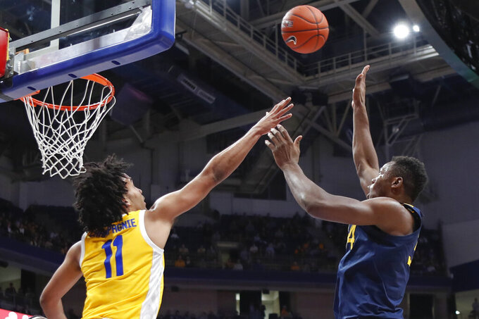 Tshiebwe's double-double leads WVU past Pitt 68-53