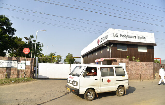 An ambulance drives past the LG Polymers plant from where chemical gas leaked in Vishakhapatnam, India, Thursday, May 7, 2020. Synthetic chemical styrene leaked from the industrial plant in southern India early Thursday, leaving people struggling to breathe and collapsing in the streets as they tried to flee. Administrator Vinay Chand said several people fainted on the road and were rushed to a hospital. (AP Photo)