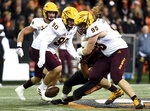 Oregon State running back Artavis Pierce fumbles the ball as he is hit by Arizona State defensive lineman Roe Wilkins during the second half of an NCAA college football game in Corvallis, Ore., Saturday, Nov. 16, 2019. (AP Photo/Steve Dykes)