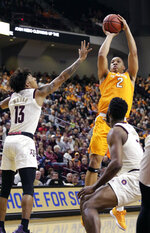 Tennessee forward Grant Williams (2) shoots over Texas A&M guard Brandon Mahan (13) and forward Josh Nebo, right, during the first half of an NCAA college basketball game Saturday, Feb. 2, 2019, in College Station, Texas. (AP Photo/Michael Wyke)