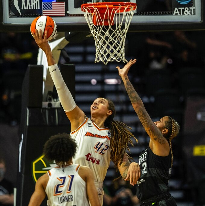 Phoenix Mercury's Brittney Griner gets a reverse layup against the Seattle Storm during the second half of a WNBA basketball game Friday, Sept. 17, 2021, in Everett, Wash. (Dean Rutz/The Seattle Times via AP)