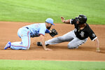 Chicago White Sox's Jose Abreu, right, slides safely into second base in front of a tag by Texas Rangers shortstop Isiah Kiner-Falefa, left, on a force play in the seventh inning of a baseball game in Arlington, Texas, Sunday, Sept. 19, 2021. (AP Photo/Matt Strasen)