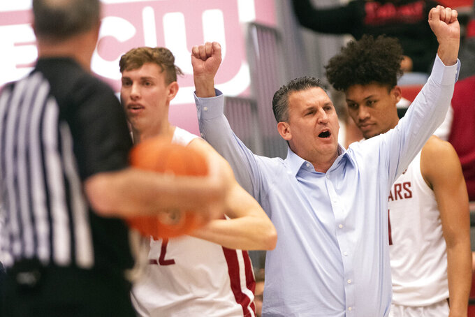 Washington State coach Kyle Smith calls out a play during the first half of the team's NCAA college basketball game against Oregon on Thursday, Jan. 16, 2020, in Pullman, Wash. (AP Photo/Pete Caster)