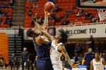 West Virginia forward Derek Culver (1) shoots over Oklahoma State forward Kalib Boone (22) in the first half of an NCAA college basketball game Monday, Jan. 4, 2021, in Stillwater, Okla. (AP Photo/Sue Ogrocki)