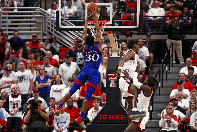 Kansas' Ochai Agbaji (30) tries to dunk the ball during the first half of an NCAA college basketball game against Texas Tech, Saturday, March 7, 2020, in Lubbock, Texas. (AP Photo/Brad Tollefson)