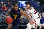 California's Paris Austin drives around Stanford's Tyrell Terry during the first half of an NCAA college basketball game in the first round of the Pac-12 men's tournament Wednesday, March 11, 2020, in Las Vegas. (AP Photo/John Locher)