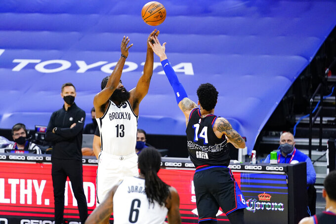 Brooklyn Nets' James Harden (13) goes up for a shot against Philadelphia 76ers' Danny Green (14) during the first half of an NBA basketball game, Saturday, Feb. 6, 2021, in Philadelphia. (AP Photo/Matt Slocum)