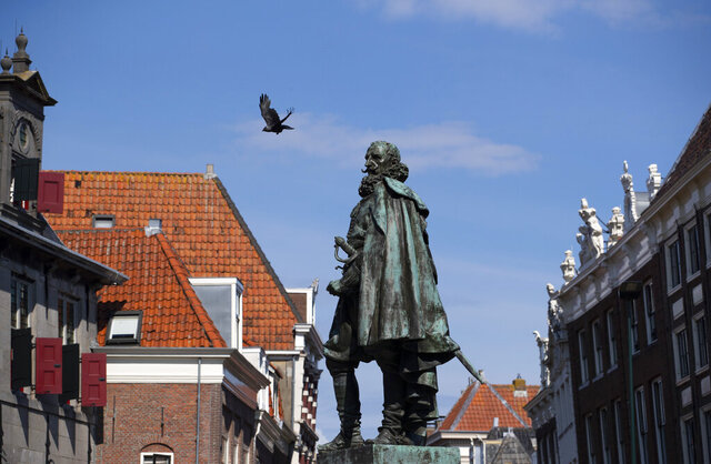 A statue of the Dutch Golden Age trader and brutal colonialist Jan Pieterszoon Coen stands tall above a square in his hometown of Hoorn, north of Amsterdam, Netherlands, Friday, June 19, 20202. Coen was a leading figure in 17th-century trading powerhouse the Dutch East India Company, but has gone down in history as the