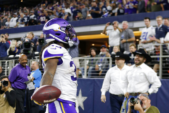 Minnesota Vikings running back Dalvin Cook (33) celebrates his rushing touchdown during the second half of the team's NFL football game against the Dallas Cowboys in Arlington, Texas, Sunday, Nov. 10, 2019. (AP Photo/Michael Ainsworth)