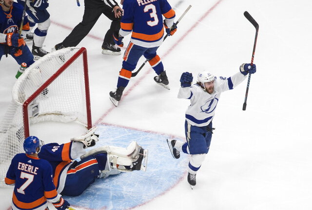 Tampa Bay Lightning's Brayden Point (21) celebrates his goal against New York Islanders goalie Semyon Varlamov (40) during the third period of an NHL Eastern Conference final playoff game in Edmonton, Alberta, on Sunday, Sept. 13, 2020. (Jason Franson/The Canadian Press via AP)