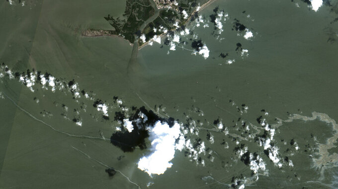 In a satellite image provided by Maxar Technologies, an oil slick is shown on Sept. 2, 2021 south of Port Fourchon, La.  The U.S. Coast Guard said Saturday, Sept. 4,  that cleanup crews are responding to a sizable oil spill in the Gulf of Mexico following Hurricane Ida.  (Maxar Technologies via AP)