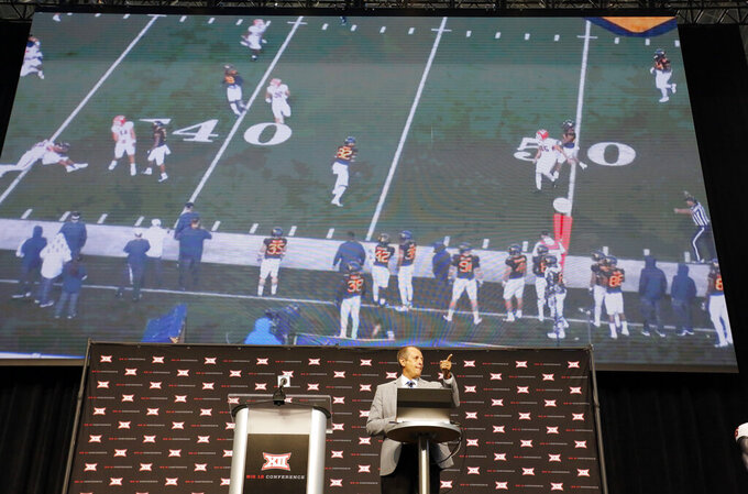 Big 12 Coordinator of Officials Greg Burks describes rule changes for the upcoming season during Big 12 Conference NCAA college football media day Tuesday, July 16, 2019, at AT&T Stadium in Arlington, Texas. (AP Photo/David Kent)