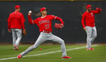 Los Angeles Angels' Shohei Ohtani (17) throws during a spring training baseball practice on Wednesday, Feb. 14, 2018, in Tempe, Ariz. (AP Photo/Ben Margot)