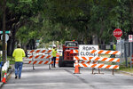 A city street is seen closed for repairs and upgrades,Thursday, April 1, 2021, in Orlando, Fla. As part of an infrastructure proposal by the Biden administration, $115 billion is earmarked to modernize the bridges, highways and roads that are in the worst shape. (AP Photo/John Raoux)