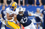FILE - In this Sept. 22, 2018, file photo, BYU linebacker Jackson Kaufusi (47) tackles McNeese State quarterback Cody Orgeron, left, in the second half during an NCAA college football game in Provo, Utah. LSU coach Ed Orgeron, who helps oversee the defensive line, likes nothing more than seeing his pass rushers cause misery for opposing quarterbacks. This week, the opposing quarterback will be his son, Cody Orgeron, setting up an unusual matchup for both the Tigers' coach and McNeese State's signal caller. (AP Photo/Rick Bowmer, File)