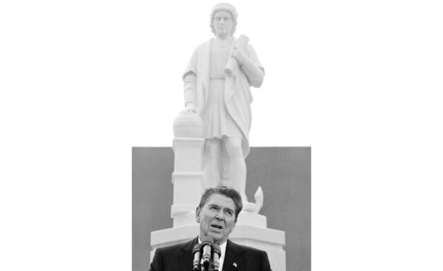 FILE - In this Monday, Oct. 9, 1984, file photo, President Ronald Reagan addresses a ceremony in Baltimore, to unveil a statue of Christopher Columbus. Baltimore protesters pulled down the statue of Christopher Columbus and threw it into the city's Inner Harbor, Saturday, July 4, 2020. (AP Photo/Lana Harris, File)