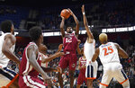 Massachusetts' Carl Pierre (12) shoots during the first half of an NCAA college basketball game against Virginia, Saturday, Nov. 23, 2019, in Uncasville, Conn. (AP Photo/Jessica Hill)