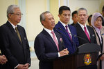 Malaysian Prime Minister Muhyiddin Yassin, center, speaks during a press conference after his first cabinet meeting at Prime Minister's Office in Putrajaya, Malaysia, on March 11, 2020. Muhyiddin said Monday, Oct. 26, 2020 his government was prioritizing protecting people from COVID-19 amid a new outbreak after the king rejected an emergency proposal that critics saw as an undemocratic attempt to hold onto power. (AP Photo/Vincent Thian)