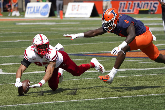Nebraska wide receiver Chris Hickman is unable to catch a pass from quarterback Adrian Martinez as Illinois defensive back Derrick Smith defends during the second half of an NCAA college football game Saturday, Aug. 28, 2021, in Champaign , Ill. Illinois won 30-22. (AP Photo/Charles Rex Arbogast)