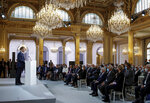 French President Emmanuel Macron delivers a speech during a meeting in memory of the Algerians who fought alongside French colonial forces in Algeria's war, known as Harkis, at the Elysee Palace in Paris, Thursday, Sept. 20, 2021. Macron's speech is the latest step in his efforts to reconcile France with its dark colonial past, especially in Algeria. (Gonzalo Fuentes/Pool Photo via AP)