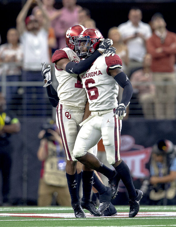 Oklahoma cornerback Tre Brown (6) celebrates his safety with cornerback Parnell Motley (11) during the Big 12 Conference championship NCAA college football game against Texas in Arlington, Texas, on Saturday, Dec. 1, 2018.  (Nick Wagner/Austin American-Statesman via AP)