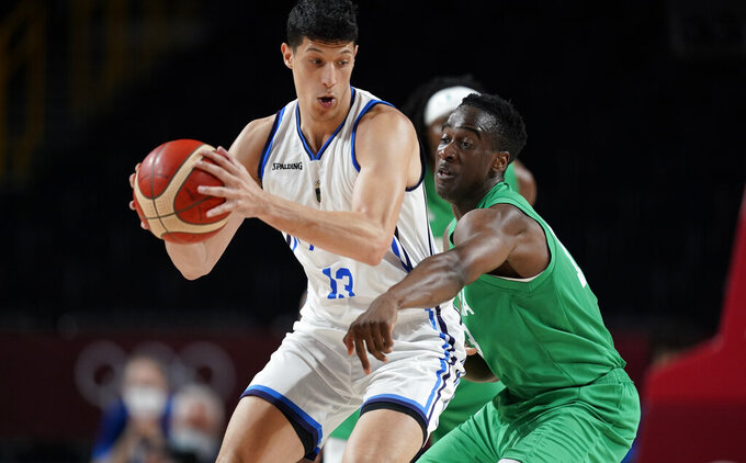 Nigeria's Olumiye Oni (13), right, tries to steal the ball by Italy's Simone Fontecchio (13), left, during men's basketball preliminary round game at the 2020 Summer Olympics, Saturday, July 31, 2021, in Saitama, Japan. (AP Photo/Charlie Neibergall)