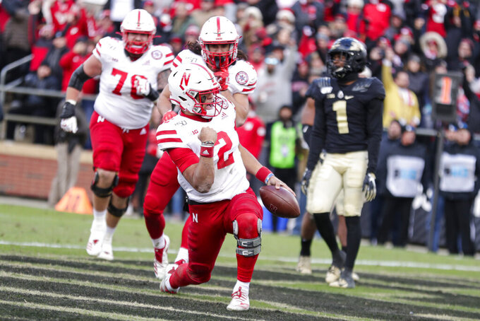 Nebraska quarterback Adrian Martinez (2) celebrates a touchdown against Purdue during the second half of an NCAA college football game in West Lafayette, Ind., Saturday, Nov. 2, 2019. Purdue defeated Nebraska 31-27. (AP Photo/Michael Conroy)