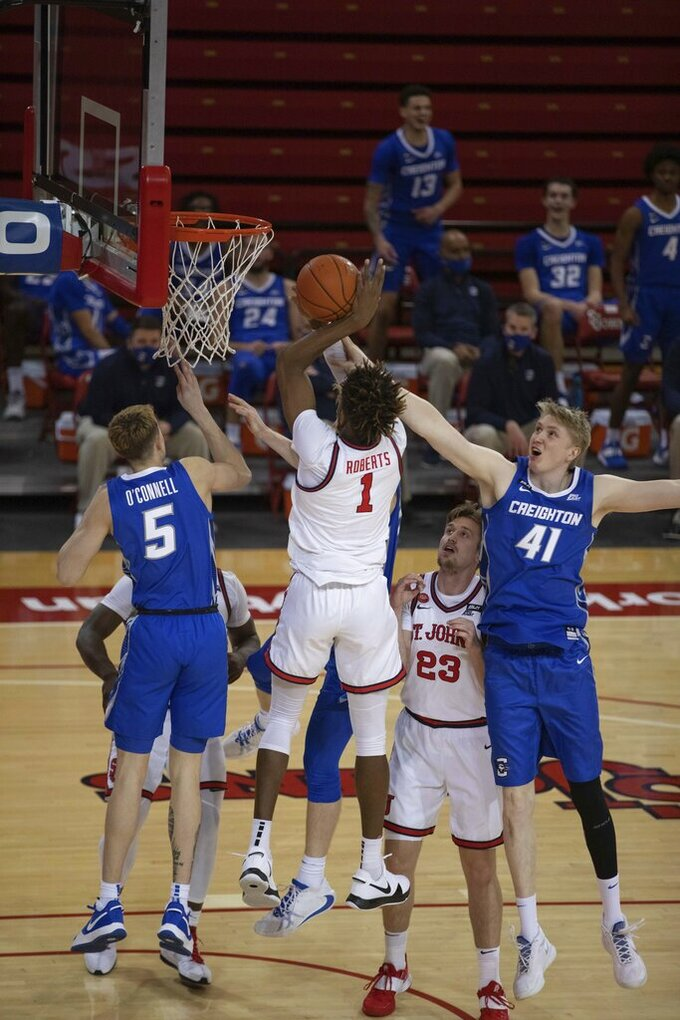 St. John's forward Josh Roberts catches a rebound during the second half of an NCAA college basketball game against Creighton, Thursday, Dec. 17, 2020, in New York. (AP Photo/Kevin Hagen)