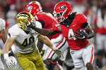 Georgia running back James Cook (4) runs against Notre Dame linebacker Drew White (40) during the second half of an NCAA college football game, Saturday, Sept. 21, 2019, in Athens, Ga. (AP Photo/Mike Stewart)