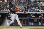 Cleveland Indians' Yasiel Puig hits a home run during the seventh inning of a baseball game against the New York Yankees, Friday, Aug. 16, 2019, in New York. (AP Photo/Frank Franklin II)