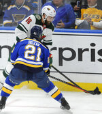 Minnesota Wild's Jason Zucker (16) looks to pass around St. Louis Blues' Tyler Bozak (21) during the second period of an NHL hockey game, Wednesday, Oct. 30, 2019, in St. Louis. (AP Photo/Bill Boyce)