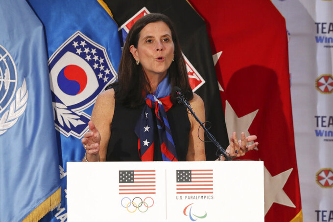 FILE - In this Aug. 1, 2017, file photo, then-U.S. Olympic Committee chief marketing officer Lisa Baird speaks about the Team USA WinterFest for the upcoming 2018 Pyeongchang Winter Olympic Games, at Yongsan Garrison, a U.S. military base in Seoul, South Korea. U.S. Soccer is no longer managing the National Women's Soccer League although some aspects of the partnership remain, NWSL Commissioner Lisa Baird said. Baird spoke Tuesday, Jan. 12,c2021, on a wide-ranging conference call with reporters ahead of the league's draft on Wednesday night.(AP Photo/Lee Jin-man, File)