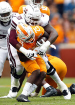 Mississippi State offensive lineman Greg Eiland (55) tackles Tennessee defensive back Trevon Flowers (25) after Flowers intercepted a pass in the first half of an NCAA college football game Saturday, Oct. 12, 2019, in Knoxville, Tenn. (AP Photo/Wade Payne)