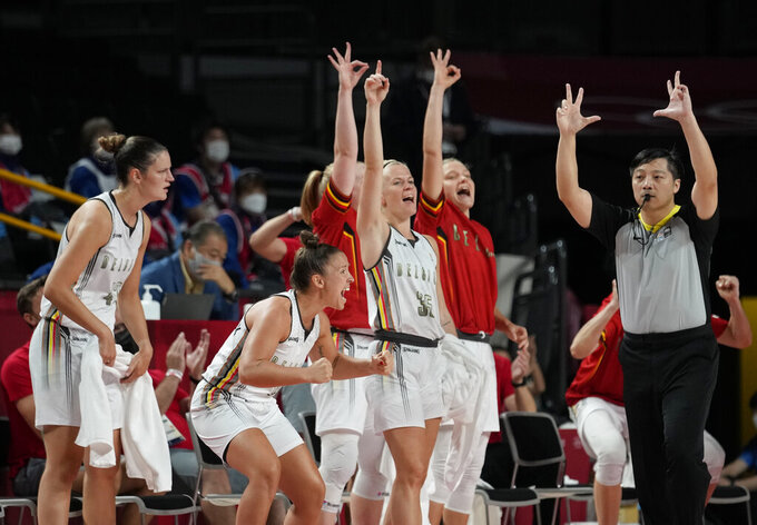 Belgium players on bench celebrate scoring by a teammate during women's basketball preliminary round game against Puerto Rico at the 2020 Summer Olympics, Friday, July 30, 2021, in Saitama, Japan. (AP Photo/Eric Gay)