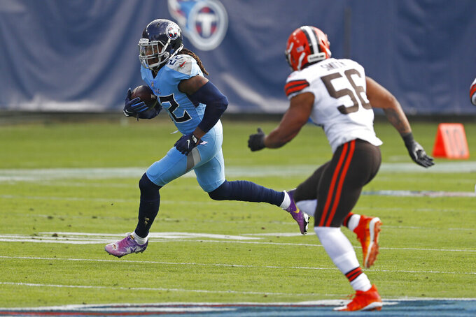 Tennessee Titans running back Derrick Henry (22) carries the ball against Cleveland Browns outside linebacker Malcolm Smith (56) in the first half of an NFL football game Sunday, Dec. 6, 2020, in Nashville, Tenn. (AP Photo/Wade Payne)